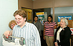 WATERBURY, CT- 02 JANUARY 2006-0102067JS10-Kennedy High School nurse Margaret Owens, left, weigh in student Bryan Osborne as students Jasmine Foster and Stacy Lopes and vice-principal Patricia Moore look on as Osborn is weighed-in as part of the school's weight loss &quot;Biggest Looser&quot; program. 148 students, administrators and community members are participating in the 12-week event meant to raise awareness on obesity and promoting a healthy lifestyle. <br /> Jim Shannon/Republican-American