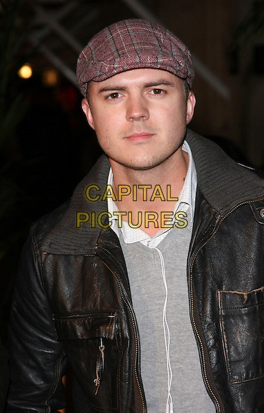 DARREN JEFFRIES .Attending the Gala VIP Opening Night of Cirque du Soleil's 'Varekai' at the Royal Albert Hall, London, England, UK, .January 5th 2010..arrivals portrait headshot cap hat red plaid tweed leather jacket grey gray brown .CAP/ROS.©Steve Ross/Capital Pictures.