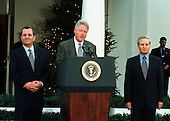 Washington, DC - December 16, 1999 -- United States President Bill Clinton makes remarks following the conclusion of two days of talks in Washington between Prime Minister Ehud Barak of Israel (left) and Foreign Minister Farouk al-Sharaa of Syria (right) on 16 December, 1999..Credit: Ron Sachs / CNP