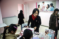 A Mary Kay cosmetics representative demonstrates beauty products to potential customers in Nanjing, Jiangsu, China.