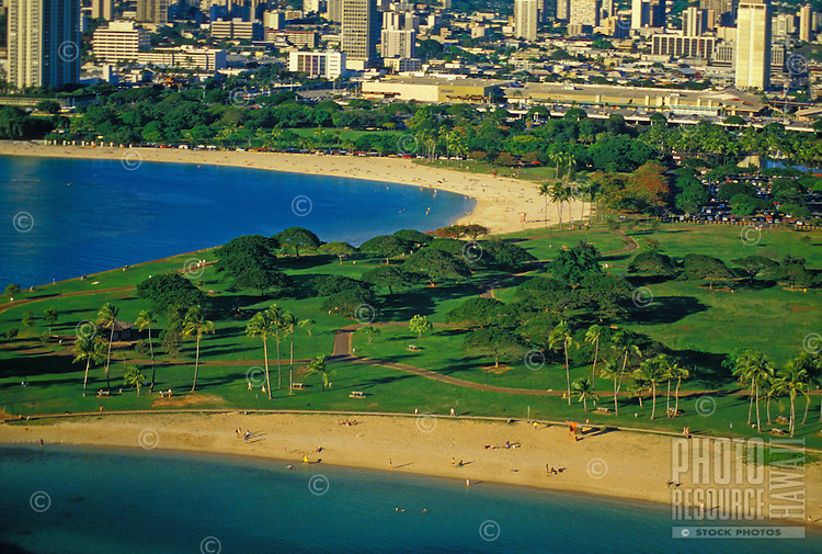 Aerial view of magic island beach park with ala moana beach and shopping center, Oahu.