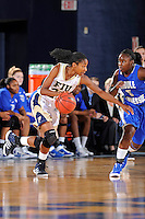 12 January 2012:  FIU guard Jerica Coley (22) attempts to drive to the basket around Middle Tennessee State guard Shanice Cason (5) in the first half as the Middle Tennessee State University Blue Raiders defeated the FIU Golden Panthers, 74-60, at the U.S. Century Bank Arena in Miami, Florida.