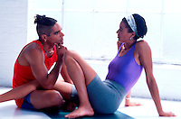 Couple relaxing and talking after workout.