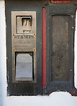 Old disused stamp vending machine and post box
