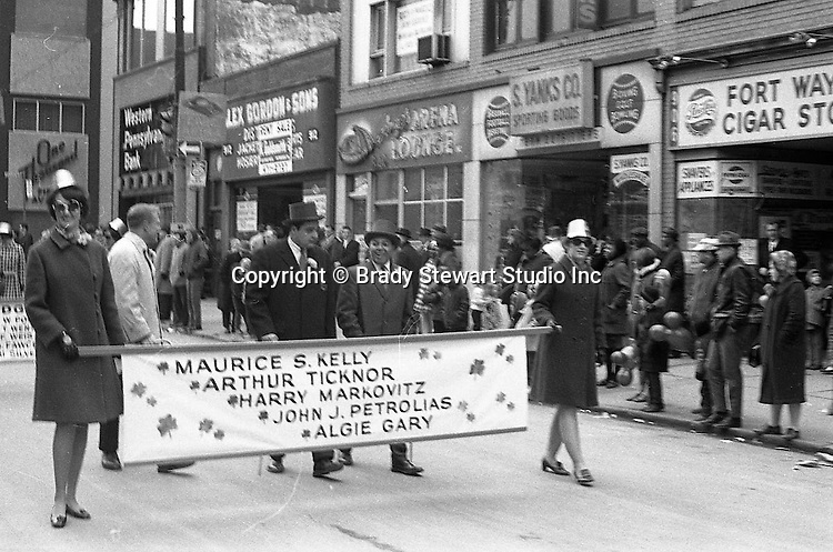 Pittsburgh PA:  View of the annual Pittsburgh Saint Patrick's Day parade on Fifth Avenue - 1969.  View is uptown near the Civic Arena. All the local politicians and judges were actively involved in the festivities.