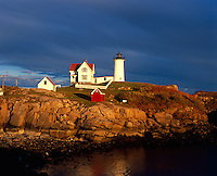 York County, ME<br /> Cape Neddick (&quot;Nubble&quot;) Light Station (1879) in evening light under darkening storm clouds