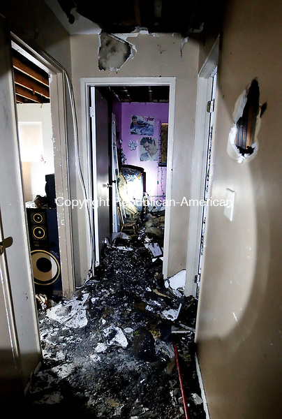 Naugatuck, CT-10 December 2012-121012CM01-  A fire damaged the hallway of this apartment at 933 Rubber Avenue in Naugatuck.  Rosie Melendez, who rents the unit and her family have been forced from the home.   Christopher Massa Republican-American