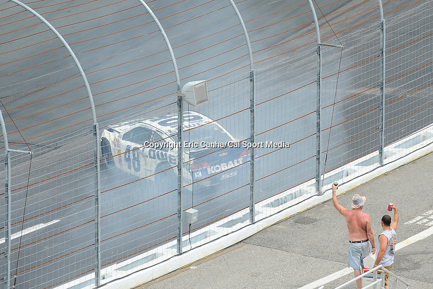 July 13, 2014 - Loudon, New Hampshire, U.S. - Sprint Cup Series driver Jimmie Johnson (48) hits the wall between turns 1 and 2 during the NASCAR Sprint Cup Series Camping World RV 301 race held at the New Hampshire Motor Speedway in Loudon, New Hampshire. Eric Canha/CSM