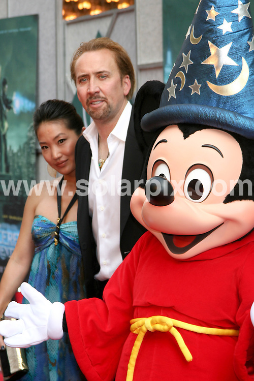 **ALL ROUND PICTURES FROM SOLARPIX.COM**.**SYNDICATION RIGHTS FOR UK, AUSTRALIA, DENMARK, PORTUGAL, S. AFRICA, SPAIN & DUBAI The Sorcerers Apprentice World Premiere - Arrivals, New Amsterdam Theatre, 214 West 42nd Street, NY, USA, 06 July  2010.This pic: Nicholas Cage and Mickey Mouse.JOB REF: 11623  PHZ gaboury    DATE: 06_07_2010.**MUST CREDIT SOLARPIX.COM OR DOUBLE FEE WILL BE CHARGED**.**MUST NOTIFY SOLARPIX OF ONLINE USAGE**.**CALL US ON: +34 952 811 768 or LOW RATE FROM UK 0844 617 7637**