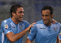 Calcio, Serie A: Lazio vs Udinese. Roma, stadio Olimpico, 13 settembre 2015.<br /> Lazio&rsquo;s Alessandro Matri, left, celebrates with teammate Stefano Mauri after scoring during the Italian Serie A football match between Lazio and Udinese at Rome's Olympic stadium, 13 September 2015.<br /> UPDATE IMAGES PRESS/Isabella Bonotto