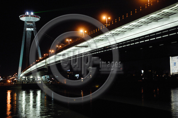"""BRATISLAVA - SLOVAKIA 9. MARCH 2007 -- A night view of the 'new bridge' with the tower with the restaurant """"Ufo"""" at the river Danube (Donau)  -- PHOTO: GORM K. GAARE / EUP & IMAGES..This image is delivered according to terms set out in """"Terms - Prices & Terms"""". (Please see www.eup-images.com for more details)"""