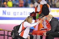 SCHAATSEN: HEERENVEEN: Thialf, Essent ISU World Cup, 02-03-2012, 1500m Håvard Bøkko (NOR), 3rd in 1,47,21, after the race with his coach Peter Mueller, ©foto: Martin de Jong