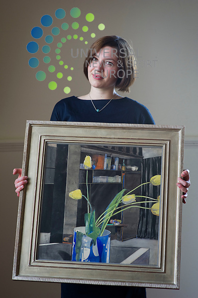 US Media Magnate, the late Donald L. Taffner, is to sell a million pound private collection of Rennie Mackintosh chairs and art work at Lyon and Turnbull in Edinburgh, Scotland, 26th July 2012. PicturedCharlotte Riordan a picture specialist at Lyon and Turnbull, Art work, 'Yellow Tulips' by Charles Rennie Mackintosh, Mahogany card room chair by Charles Rennie Mackintosh..Picture:Scott Taylor Universal News And Sport (Europe) .All pictures must be credited to www.universalnewsandsport.com. (Office)0844 884 51 22.