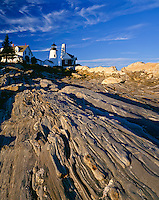 Lincoln County, ME<br /> Pemaquid Point Lighthouse (1835)above the wave worn granite rock forms of Pemaquid Point