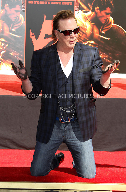 WWW.ACEPIXS.COM . . . . .  ..... . . . . US SALES ONLY . . . . .....October 31 2011, LA....Mickey Rourke at his Hollywood Walk of Fame hand and footprint ceremony held at Grauman's Chinese Theater on October 31 2011in Hollywood, Los Angeles....Please byline: FAMOUS-ACE PICTURES... . . . .  ....Ace Pictures, Inc:  ..Tel: (212) 243-8787..e-mail: info@acepixs.com..web: http://www.acepixs.com