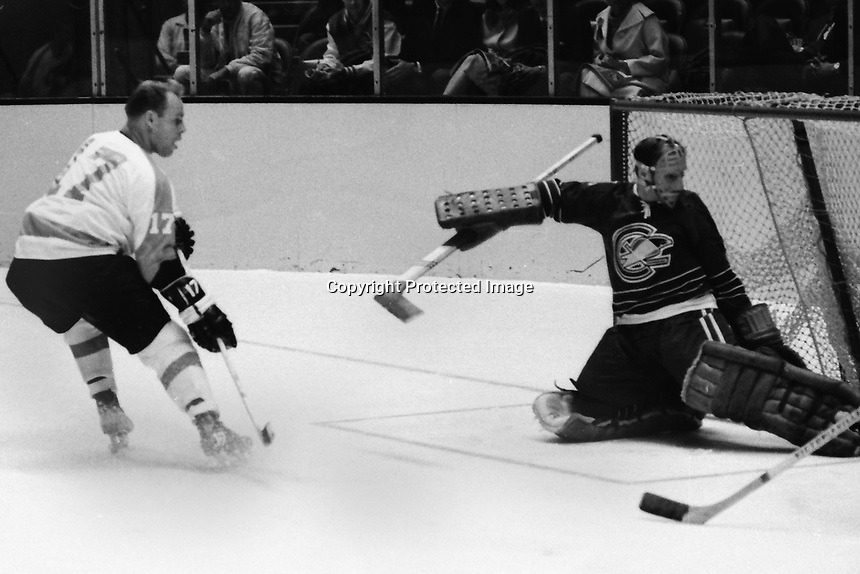 Philadelphia Flyers Wayne Hicks scores  for the Flyers against the Seals goalie Charlie Hodge. (1967 photo by Ron Riesterer)