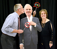 Janelle Jessen/Herald-Leader<br /> Kevin Snavely, former high school vice principal, and his wife Deanna Snavely, former assistant high school library media specialist, posed with a cardboard cutout of Superintendent Ken Ramey during his retirement party on Friday. Many current and former employees attended the event.