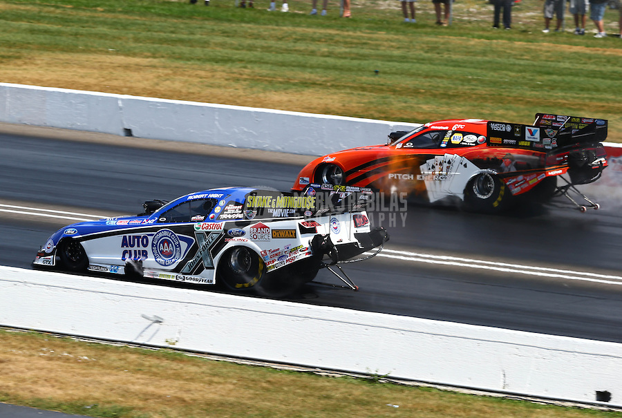Sept. 2, 2013; Clermont, IN, USA: NHRA funny car driver Robert Hight (near lane) races alongside Johnny Gray during the US Nationals at Lucas Oil Raceway. Mandatory Credit: Mark J. Rebilas-