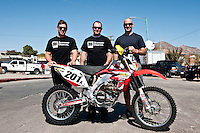Team 201x pose for portrait with motorcycle, 2012 San Felipe Baja 250, Baja California, Mexico