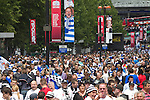 Rival fans thronging Olympic Way on their way to the Npower Championship play-off final between Reading (blue) and Swansea City at Wembley Stadium. The match was won by Swansea by 4 goals to 2 watched by a crowd of 86,581. Swansea became the first Welsh team to reach the top division of English football since they themselves played there in 1983.
