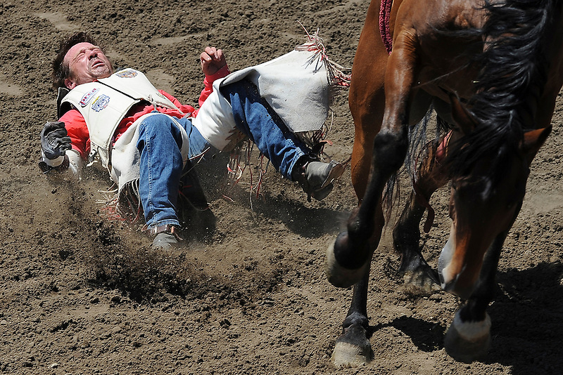Chris Harris of Itasca, Texas finds the hard way off of Big Easy during the bareback bronc riding on Sunday of the 100th annual California Rodeo Salinas in 2011.