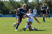 Sanford, FL - Saturday Oct. 14, 2017:  A Pride defender makes a sliding tackle during a US Soccer Girls' Development Academy match between Orlando Pride and NC Courage at Seminole Soccer Complex. The Courage defeated the Pride 3-1.