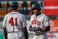Quad Cities River Bandits outfielder Ronnie Dawson (12) talks with development coach Jason Bell (41) during a Midwest League game against the Wisconsin Timber Rattlers on April 8, 2017 at Fox Cities Stadium in Appleton, Wisconsin.  Wisconsin defeated Quad Cities 3-2. (Brad Krause/Four Seam Images)