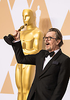Gary Oldman poses backstage with the Oscar&reg; for performance by an actor in a leading role for work on &ldquo;Darkest Hour&rdquo; during the live ABC Telecast of The 90th Oscars&reg; at the Dolby&reg; Theatre in Hollywood, CA on Sunday, March 4, 2018.<br /> *Editorial Use Only*<br /> CAP/PLF/AMPAS<br /> Supplied by Capital Pictures