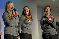 NWA Democrat-Gazette/DAVID GOTTSCHALK Shauna Estes-Taylor (from right), head women's golf coach at the University of Arkansas, listens to the introduction of golfers Jordy LaBarbera and Brooke Matthews Wednesday, March 28, 2018, at The First Tee Girls on Course: Tee Up Your Future; An Expo for Young Women at the Sam's Club Corporate Offices in Bentonville. The expo, presented by Walmart NW Arkansas Championship presented by P&G, hosted 500 seventh through 12th grade students from area schools. Students had the opportunity to listen to an assortment of executives throughout multiple industries, while also learning how to be successful in the future using The First Tee 9 Core Values.