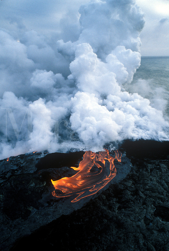 Lava flows into the Pacfic Ocean from the Kilauea Volcano on the island of Hawaii