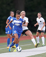 Boston Breakers forward Lianne Sanderson (10) dribbles as Portland Thorns FC midfielder Allie Long (10) pressures. In a National Women's Soccer League (NWSL) match, Boston Breakers (blue) defeated Portland Thorns FC (white/black), 2-1, at Dilboy Stadium on August 7, 2013.