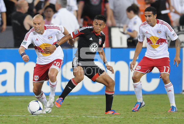 New York Red Bulls midfielder Joel Lindpere (20) shields the ball from D.C. United defender Andy Najar (14) The New York Red Bulls tied D.C. United 2-2 at RFK Stadium, Wednesday August 29, 2012.