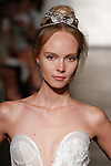 Model walks runway in a strapless dimensional sunflower lace sheath, from Inbal Dror Fall 2018 bridal collection on October 5, 2017; during New York Bridal Fashion Week.
