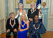 The five recipients of the 38th Annual Kennedy Center Honors pose for a group photo following a dinner hosted by United States Secretary of State John F. Kerry in their honor at the U.S. Department of State in Washington, D.C. on Saturday, December 5, 2015.  The 2015 honorees are: singer-songwriter Carole King, filmmaker George Lucas, actress and singer Rita Moreno, conductor Seiji Ozawa, and actress and Broadway star Cicely Tyson.  From left to right top: Rita Moreno and George Lucas. From left to right bottom: Seiji Ozawa, Carole King, and Cicely Tyson.<br /> Credit: Ron Sachs / Pool via CNP