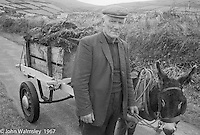 """Donkey cart carrying peat, Dunquin (in Gaelic, Dún Chaoin, meaning """"Caon's stronghold""""), on the tip of the Dingle Peninsula, County Kerry, Ireland.  1971."""