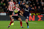 George Baldock of Sheffield United challenges Manuel Lanzini of West Ham United during the Premier League match at Bramall Lane, Sheffield. Picture date: 10th January 2020. Picture credit should read: James Wilson/Sportimage
