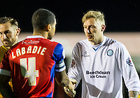 Goalkeeper Ryan Allsop of Wycombe Wanderers shakes hands with Captain Joss Labadie of Dagenham & redbridge during the Sky Bet League 2 match between Dagenham and Redbridge and Wycombe Wanderers at the London Borough of Barking and Dagenham Stadium, London, England on 9 February 2016. Photo by Andy Rowland.