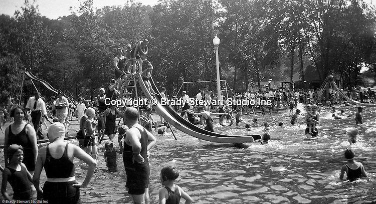 "South Park PA: Sally Stewart going down the slide at the South Park Swimming pool - 1931. The philosophy of recreation in the '20s and '30s was different than it is today. The differences between the haves and the have-nots of society was understood differently, and the county parks were called ""the people's country clubs,"" bringing to poorer people the same recreation that the wealthy paid for at private clubs: golf, tennis, swimming, picnicking. The parks offered common folk the chance to escape to rural campgrounds, day camps, and ""retreats."" Certain modern recreational concepts had not yet arrived: people didn't ""swim,"" they ""bathed""; hence, a large South Park pool was only four feet deep at its deepest point."