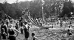 """South Park PA: Sally Stewart going down the slide at the South Park Swimming pool - 1931. The philosophy of recreation in the '20s and '30s was different than it is today. The differences between the haves and the have-nots of society was understood differently, and the county parks were called """"the people's country clubs,"""" bringing to poorer people the same recreation that the wealthy paid for at private clubs: golf, tennis, swimming, picnicking. The parks offered common folk the chance to escape to rural campgrounds, day camps, and """"retreats."""" Certain modern recreational concepts had not yet arrived: people didn't """"swim,"""" they """"bathed""""; hence, a large South Park pool was only four feet deep at its deepest point."""