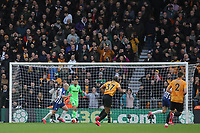 Aaron Mooy of Brighton & Hove Albion defends in front of the South Bank during Wolverhampton Wanderers vs Brighton & Hove Albion, Premier League Football at Molineux on 7th March 2020