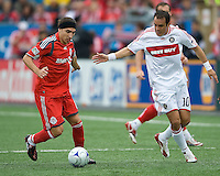 16 May 09: Chicago Fire midfielder Cuauhtemoc Blanco #10 and Toronto FC forward Pablo Vitti #8 in action at BMO Field during a game between the Chicago Fire and Toronto FC..Chicago Fire won 2-0..