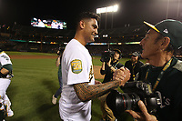 OAKLAND, CA - APRIL 21:  Sean Manaea #55 of the Oakland Athletics celebrates with photographer Michael Zagaris after the game against the Boston Red Sox at the Oakland Coliseum on Saturday, April 21, 2018 in Oakland, California. Manaea pitched a no-hitter against Boston defeating them 3-0. (Photo by Brad Mangin)