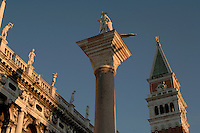 Campanile and statues in St Marks square. Venice, Italy, early morning.