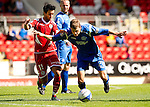 St Johnstone v Real Valladolid....07.08.10  Pre-Season Friendly.Murray Davidson fends off Bueno.Picture by Graeme Hart..Copyright Perthshire Picture Agency.Tel: 01738 623350  Mobile: 07990 594431