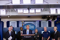United States President Donald J. Trump, center, makes remarks on the Coronavirus crisis in the Brady Press Briefing Room of the White House in Washington, DC on Saturday, March 21, 2020.<br /> Credit: Stefani Reynolds / Pool via CNP/AdMedia