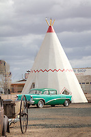 Wigwam Motel, Holbrook, Arizona. Built in 1950 by Arizona motel owner Chester E. Lewis, the plans were based on the original of Frank A. Redford.<br /> <br /> Antique trucks and automobiles are scattered throughout the property.<br /> Lewis operated the motel successfully until closing it in 1974 when Interstate 40 bypassed downtown Holbrook. Two years after his death in 1986, sons Clifton and Paul Lewis and daughter Elinor renovated the motel, finally reopening it in 1988.