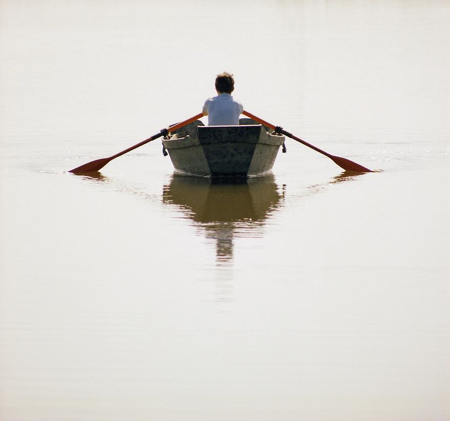 Boy Rowing Boat