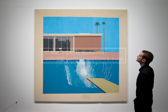 13/11/2012. London, UK. A member of Tate Modern staff views David Hockney's 'A Bigger Splash' (1967) at the press view for a new exhibition at the Tate Modern in London today (13/11/12) . The exhibition, 'A Bigger Splash: Painting After Performance', takes a look at the relationship between painting and performance, bringing together the works of over 40 artists, including Jackson Pollock and Cindy Sherman, and runs from the 14th of November 2012 to the 1st of April 2013.  Photo credit: Matt Cetti-Roberts
