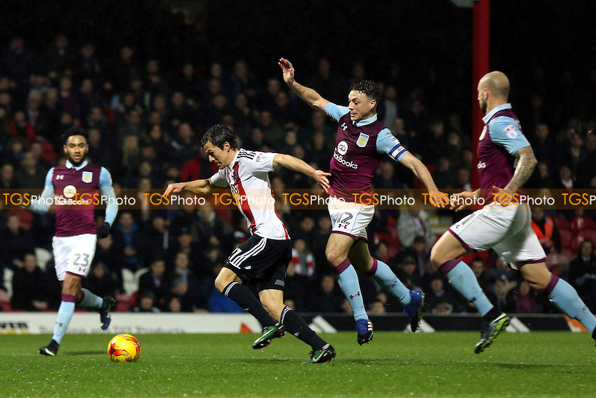 Lasse Vibe bursts through the Aston Villa defence to score Brentford's opening goal during Brentford vs Aston Villa, Sky Bet EFL Championship Football at Griffin Park on 31st January 2017