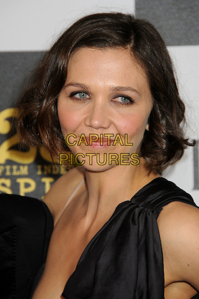 MAGGIE GYLLENHAAL.25th Annual Film Independent Spirit Awards - Arrivals held at the Nokia Event Deck at L.A. Live, Los Angeles, California, USA..March 5th, 2010.headshot portrait black one shoulder strap .CAP/ADM/BP.©Byron Purvis/AdMedia/Capital Pictures.